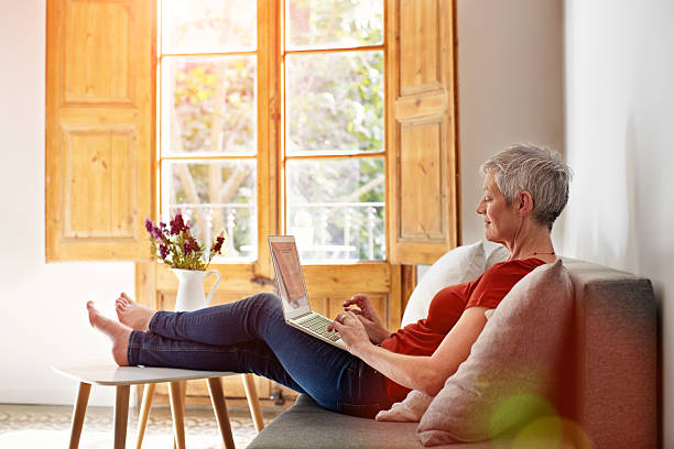 catching up with online correspondence - senior home stock photos and pictures