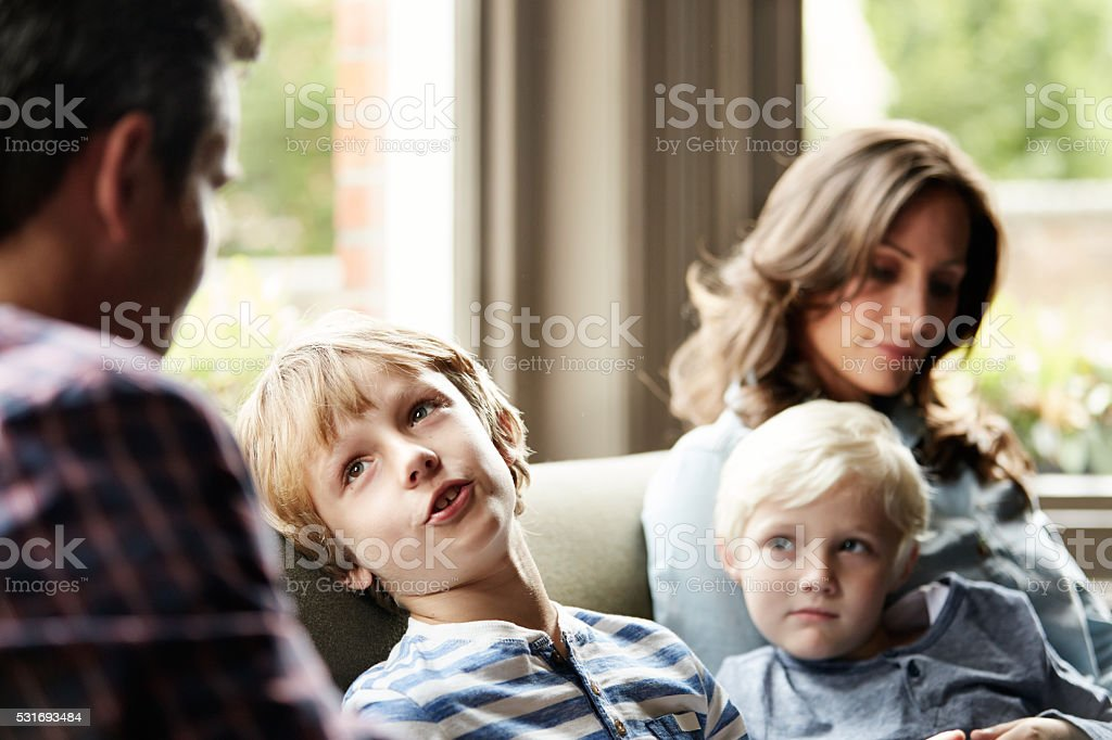 Catching up with their sons on the sofa stock photo