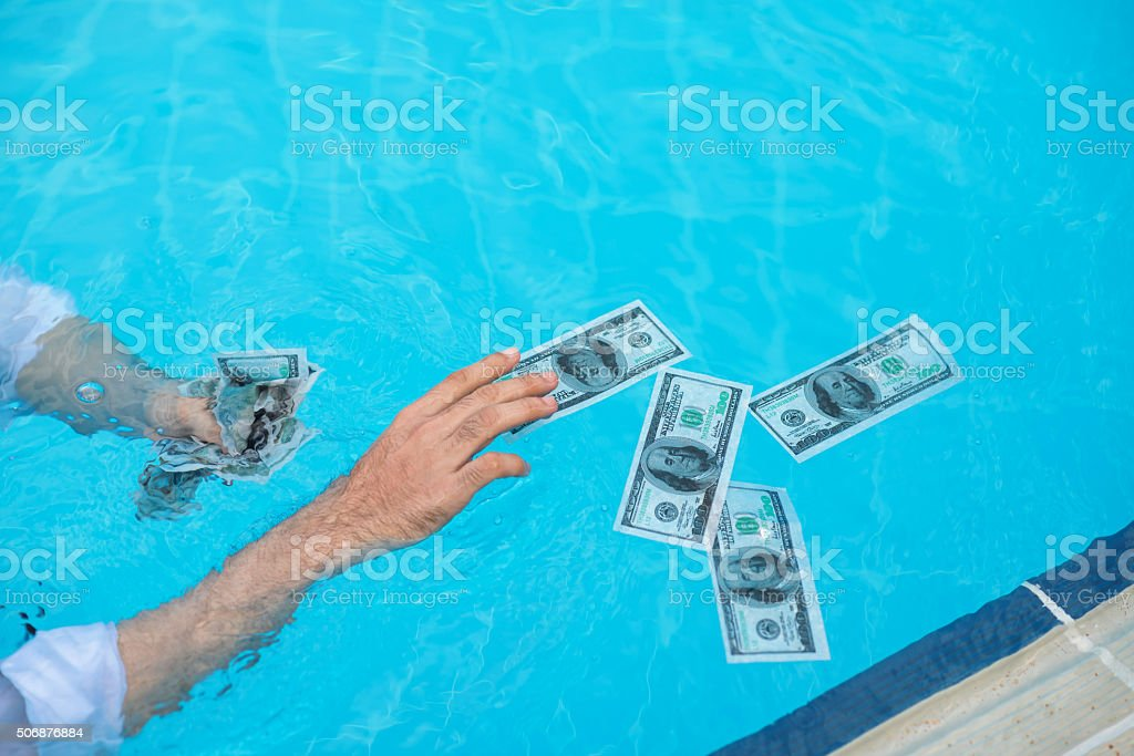 Catching wet banknotes stock photo