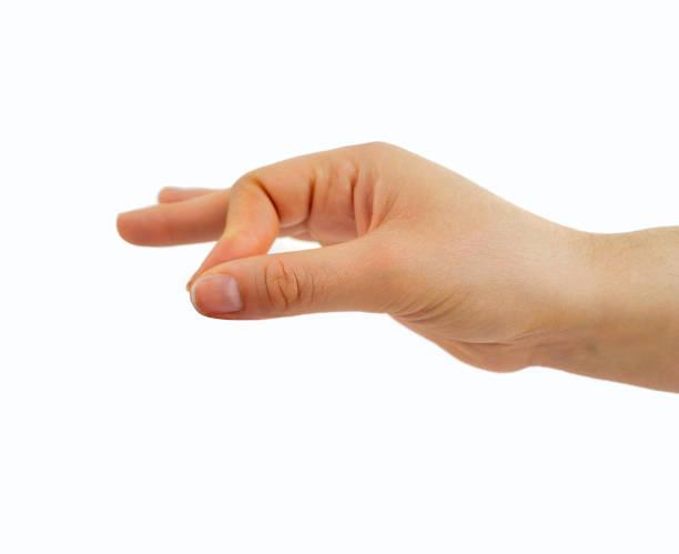 catching with fingers - mano donna dita unite foto e immagini stock