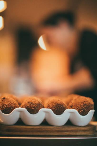 Caterer Preparing Party Food, Arancini, Cake Pop Style stock photo