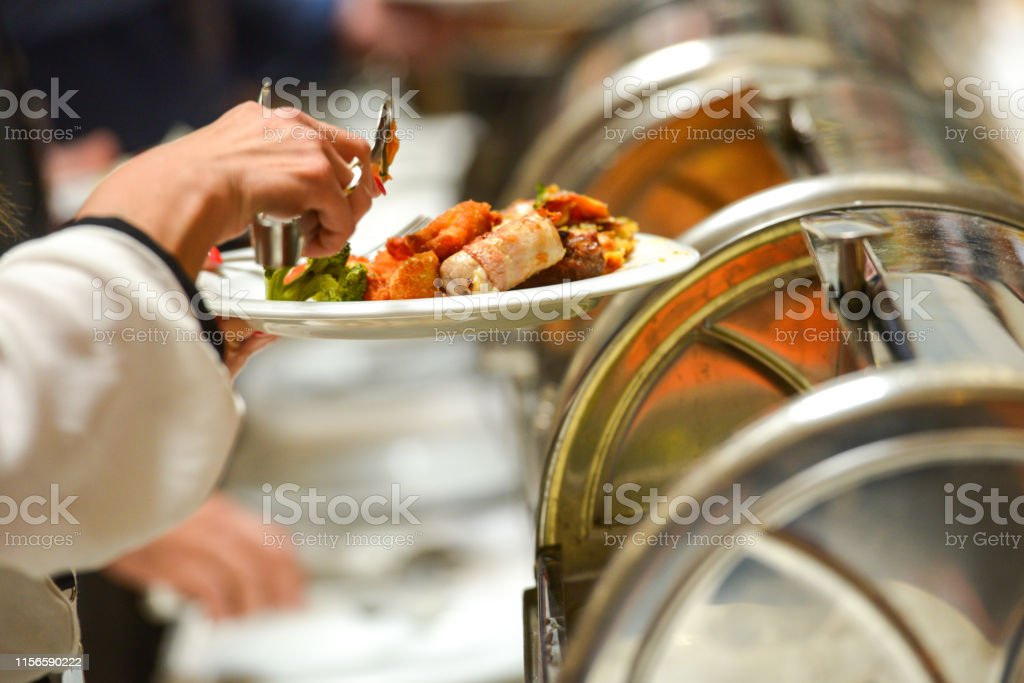 Various food served and decorated in plates at ceremony. Scene of...