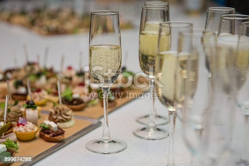 istock Catering Banquet table with canapes, snacks, festive table, slices, glasses 899674268