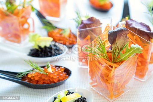 istock Catering banquet table with salad and caviar 640333762