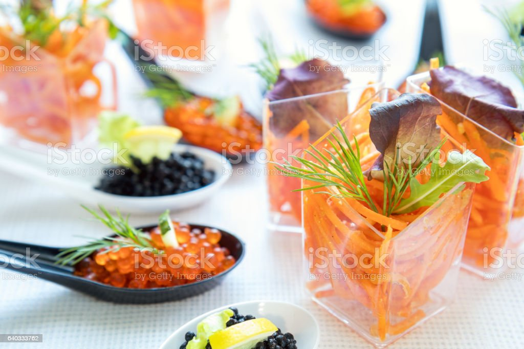 Catering banquet table with salad and caviar stock photo