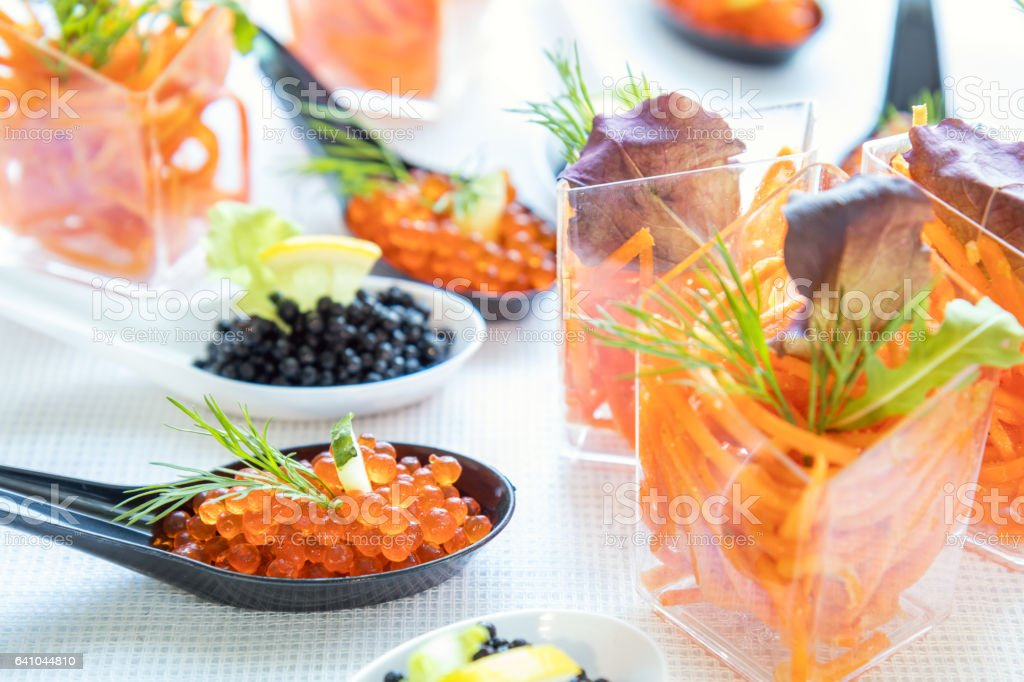 Catering banquet table with salad and caviar royalty-free stock photo