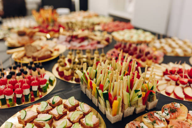catering banquet table with tiny sandwiches stock photo