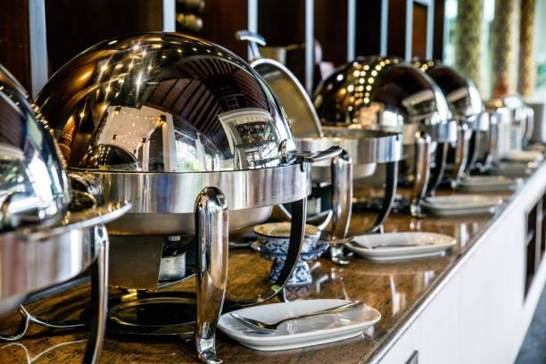 catering buffet food with heated trays ready for service - muita comida imagens e fotografias de stock