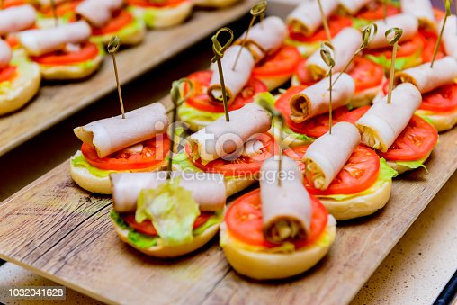istock Catering. Off-site food. Sandwiches, hamburgers and snacks 1032041628