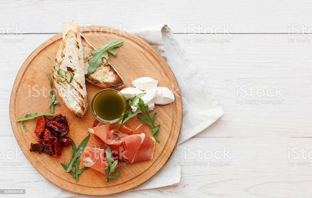 Catering platter antipasto with prosciutto and mozzarella stock photo