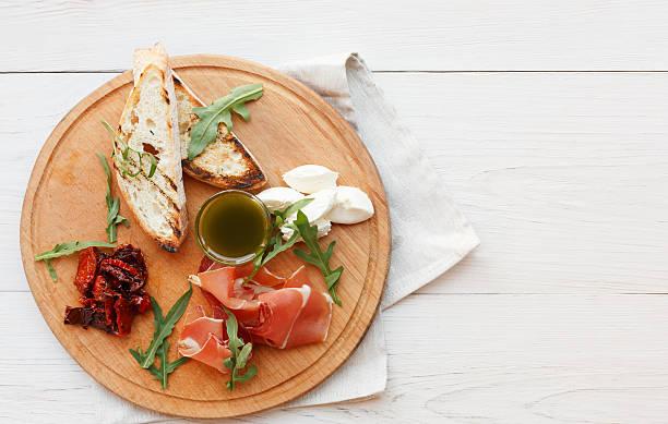 Catering platter antipasto with prosciutto and mozzarella stock photo