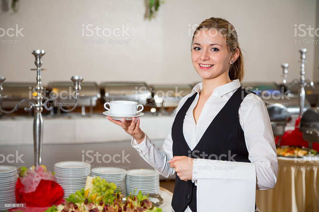 Catering service  employee in restaurant posing with soup dish stock photo