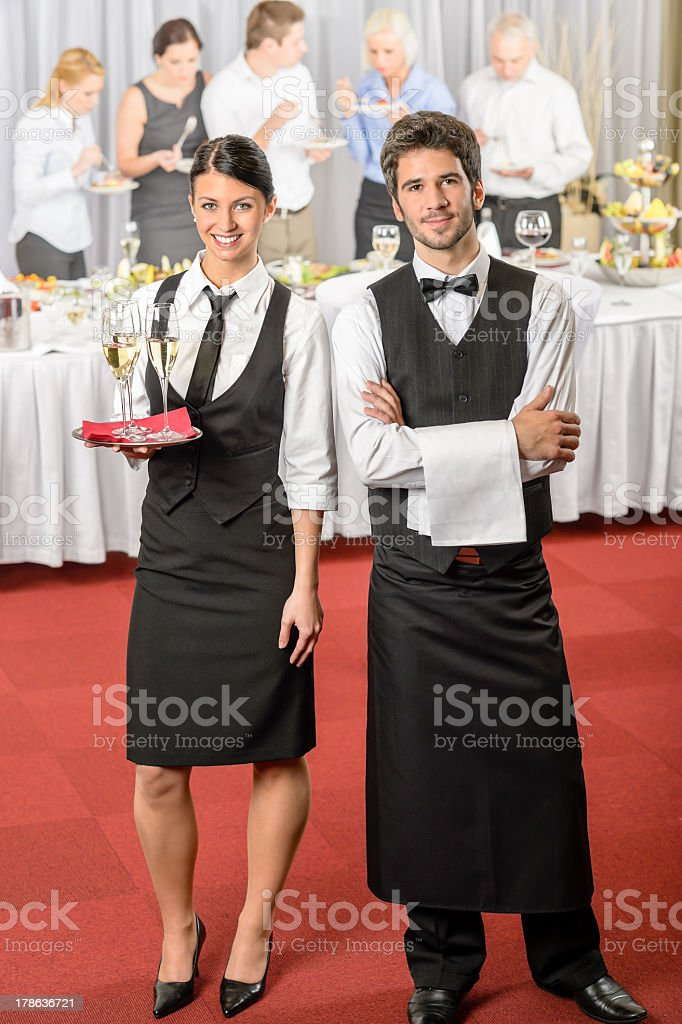 Catering service waiter, waitress business event royalty-free stock photo