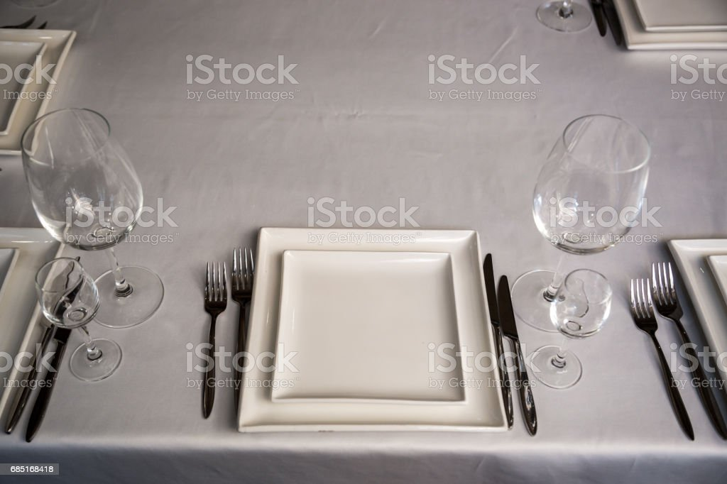 catering table set service with silverware, napkin and glass at restaurant before party royalty-free stock photo