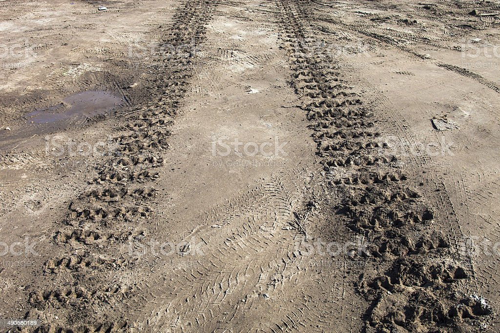Caterpillar tracks traces on the ground stock photo