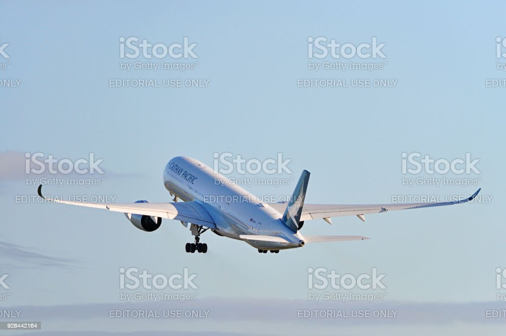 Cathay Pacific Airways Airbus A350 taking off from Manchester Airport, United Kingdom. stock photo