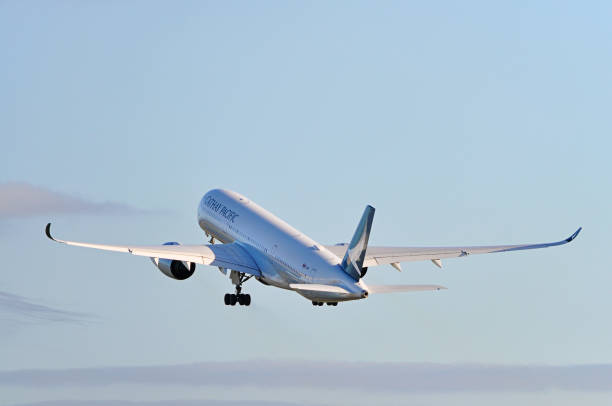 Cathay Pacific Airways Airbus A350 taking off from Manchester Airport, United Kingdom. - foto stock