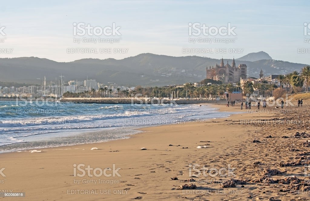 Cathedral and city beach with people stock photo
