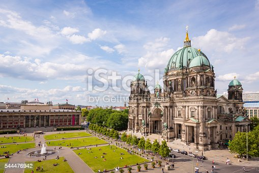 Aerial view down to with tourists and visitors crowded Lustgarten Park next to the famous Berliner Dom in Downtown Berlin, Germany.