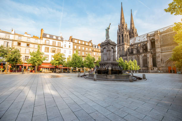 Cathedral in Clermont-Ferrand city Morning view on the Victory square with monument and cathedral in Clermont-Ferrand city in France town square stock pictures, royalty-free photos & images