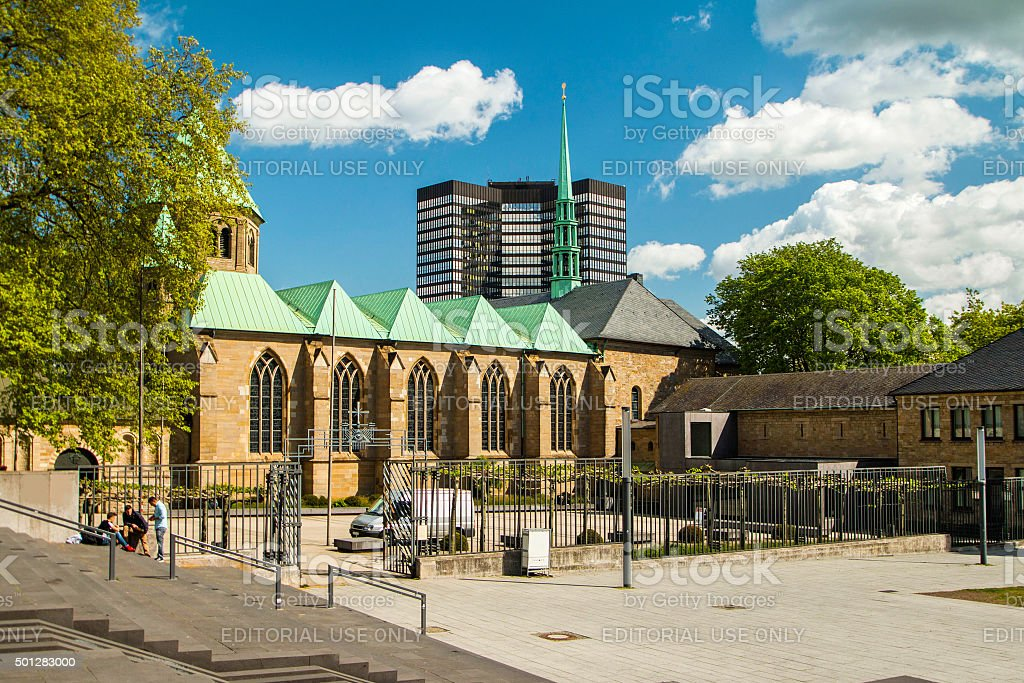 Cathedral in Essen, Germany, and modern business tower, city skyline stock photo