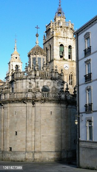 Cathedral in Lugo city, bell and clock tower, building exterior, chapel seen from town square, Galicia, Spain. Primitive camino de Santiago.