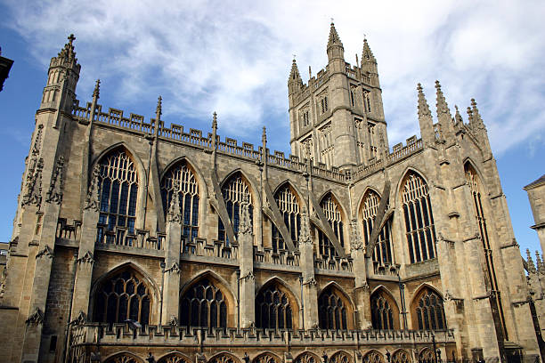 Cathedral in the Sky Bath Abbey Cathedral in England with cloudy blue sky as backdrop. bell tower tower stock pictures, royalty-free photos & images