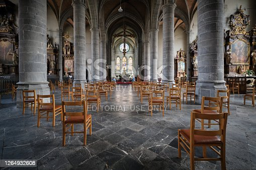 istock Cathedral interior with social distancing seats 1264932608
