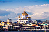 Stunning view of the orthodox cathedral of Christ the Saviour over Moskva river bridges , Moscow, Russia