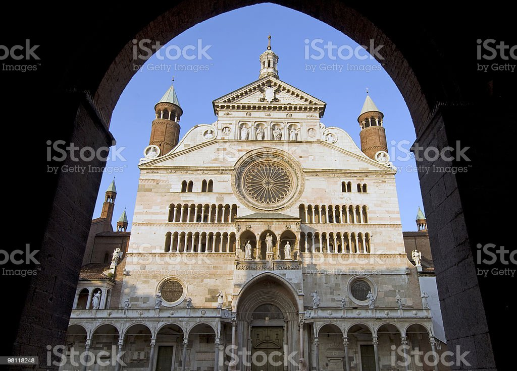 Cathedral of Cremona (Italy) - Facade through an arch royalty-free stock photo