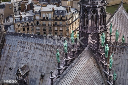 Cathedral of Notre Dame Tower facade with statues and ornate details - Paris, France