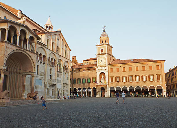 Cathedral of Santa Maria Assunta e San Geminiano of Modena. Italy. Modena, Italy - July 21, 2016.  Cathedral of Santa Maria Assunta e San Geminiano and the Palazzo Comunale, city hall, in Piazza Grande of Modena at sunset. Emilia-Romagna. piazza grande stock pictures, royalty-free photos & images