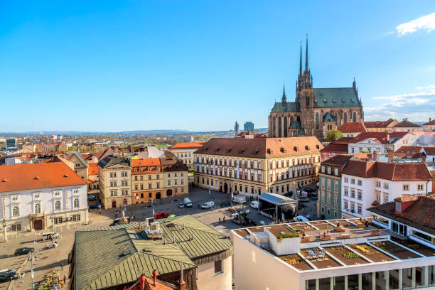 Cathedral of St Peter and Paul in Brno, Moravia, Czech Republic with town square during sunny day. Famous landmark in South Moravia. Brno, Czech Republic - April, 2018: Cathedral of St Peter and Paul in Brno, Moravia, Czech Republic with town square during sunny day. Famous landmark in South Moravia brno stock pictures, royalty-free photos & images