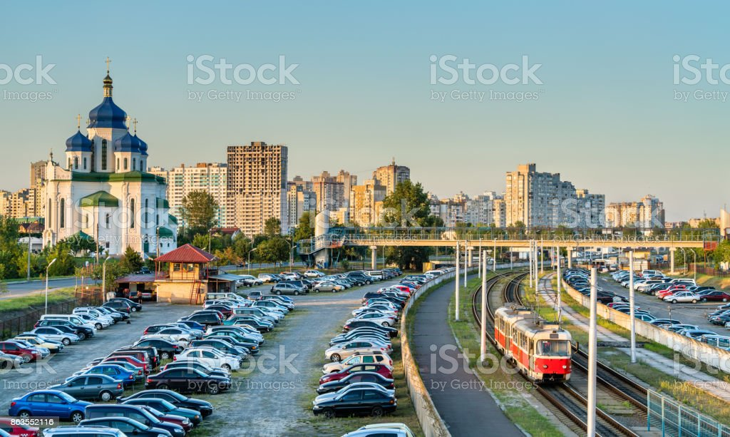 Cathedral of the Holy Trinity and a light rail tram in Troieshchyna - Kiev, Ukraine stock photo