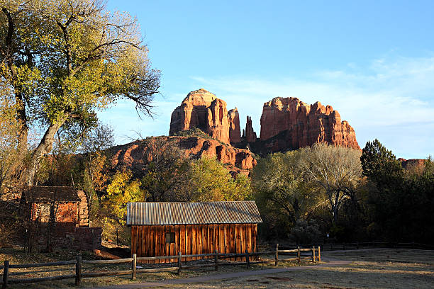 Cathedral Rock And Weathered Farm Building stock photo