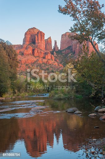 a reflection of cathedral rock in fall in oak creek near Sedona arizona