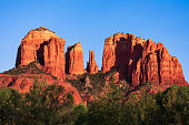 Cathedral Rock, a famous red rock landmark and popular travel destination in Sedona, Arizona at sunset.