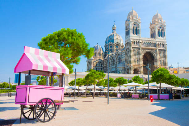 Cathedral Sainte-Marie-Majeure de Marseille (France) one of the largest catholic church in France, located near the old port - concept image with a pink ice cream cart stock photo
