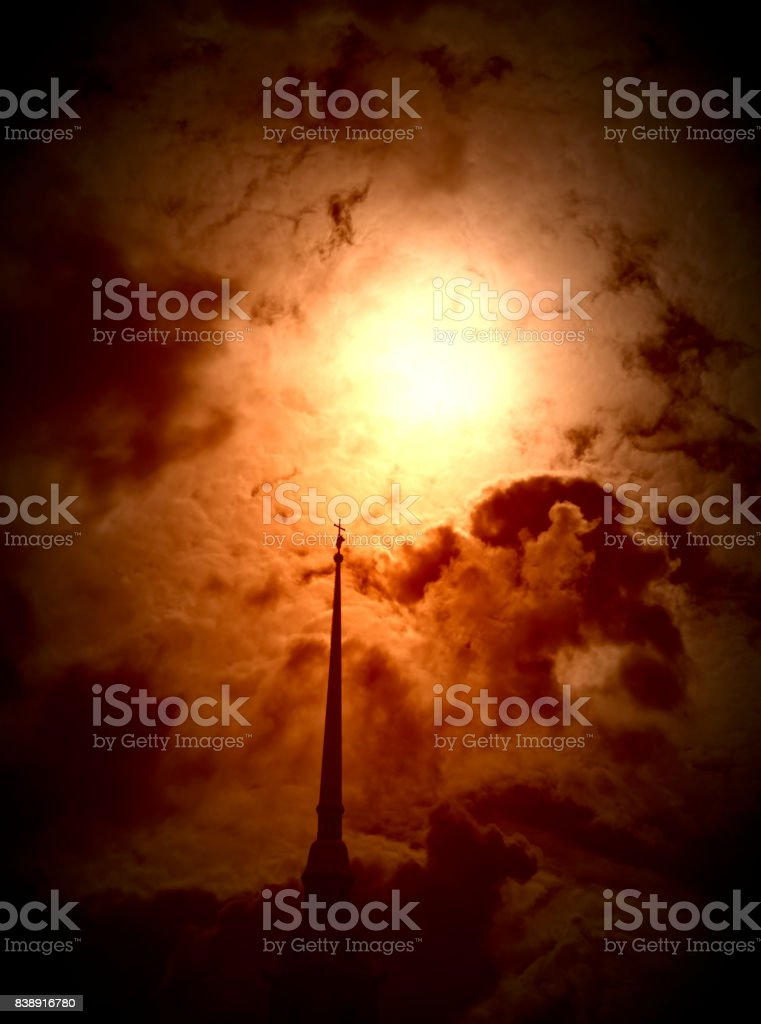 Cathedral spire and burning sky stock photo