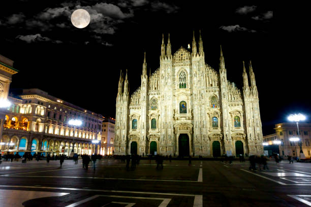 Cathedral Square with full moon in Milan, Italy