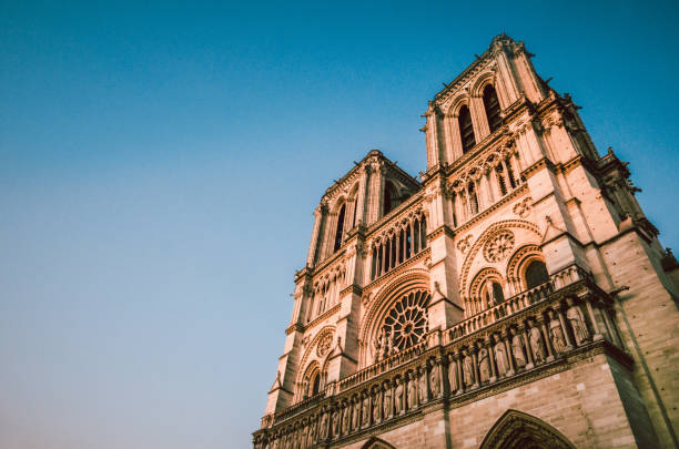 Catholic Cathedral of Paris, Notre Dame On Sunset Catholic Cathedral of Paris, Notre Dame On Sunset religious symbol stock pictures, royalty-free photos & images