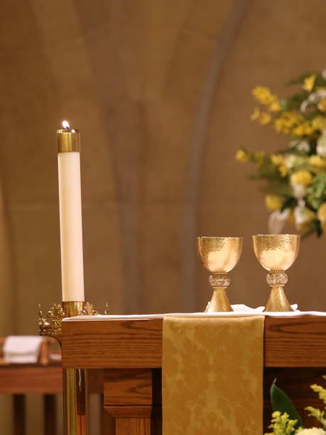 Catholic Church Candles, Wine Chalice on Altar stock photo