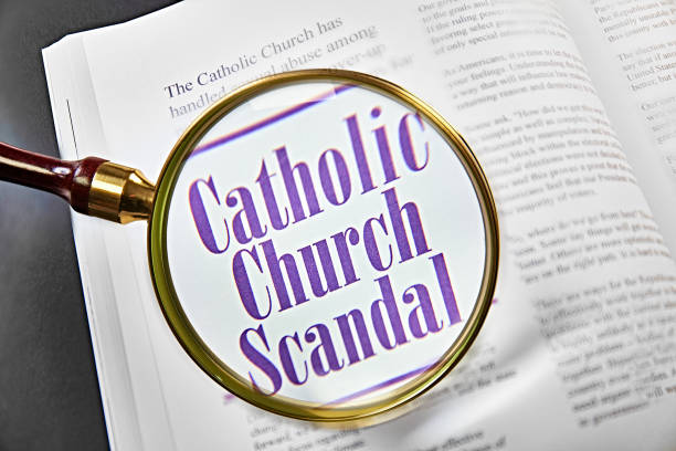 Catholic Church Scandal Catholic Church Scandal on magazine with magnifying glass+++ I wrote all the text +++ clergy stock pictures, royalty-free photos & images