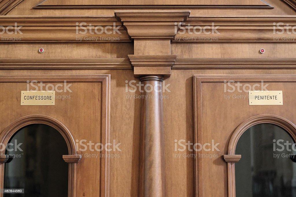 Catholic confessional area - Confessare i peccati stock photo