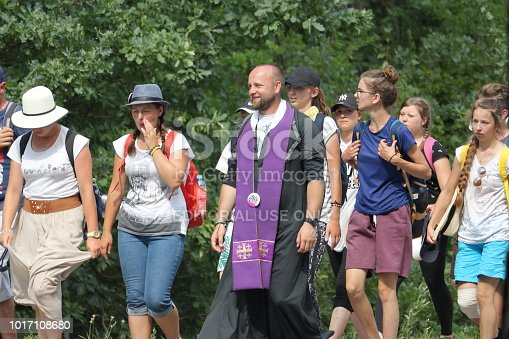 istock A Catholic priest and other pilgrims walk on the road in Samsonow, Poland, during pilgrimage to the Monastery of Jasna Gora in Czestochowa, Poland. 1017108680