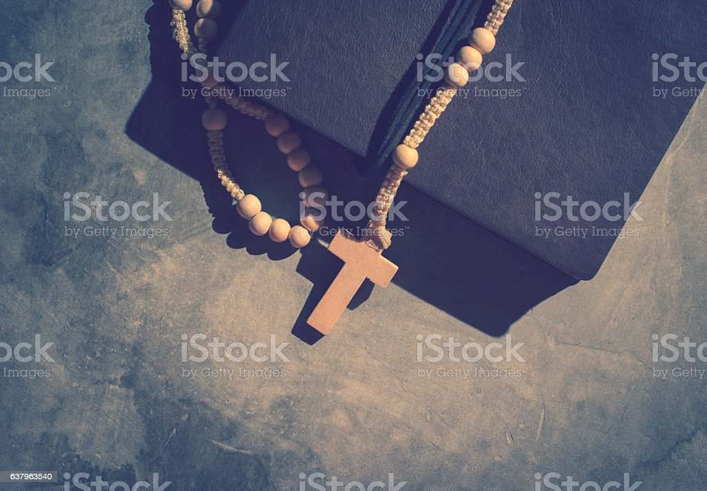 Catholic Rosary Beads With Old Book On Cement Table Prayer Stock