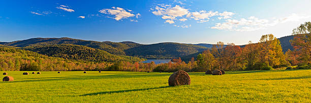 Catskills Fall Panorama Panorama of a field of hay bales above the Pepacton Reservoir, surrounded by the Catskills Mountains of New York in the Autumn. catskill mountains stock pictures, royalty-free photos & images