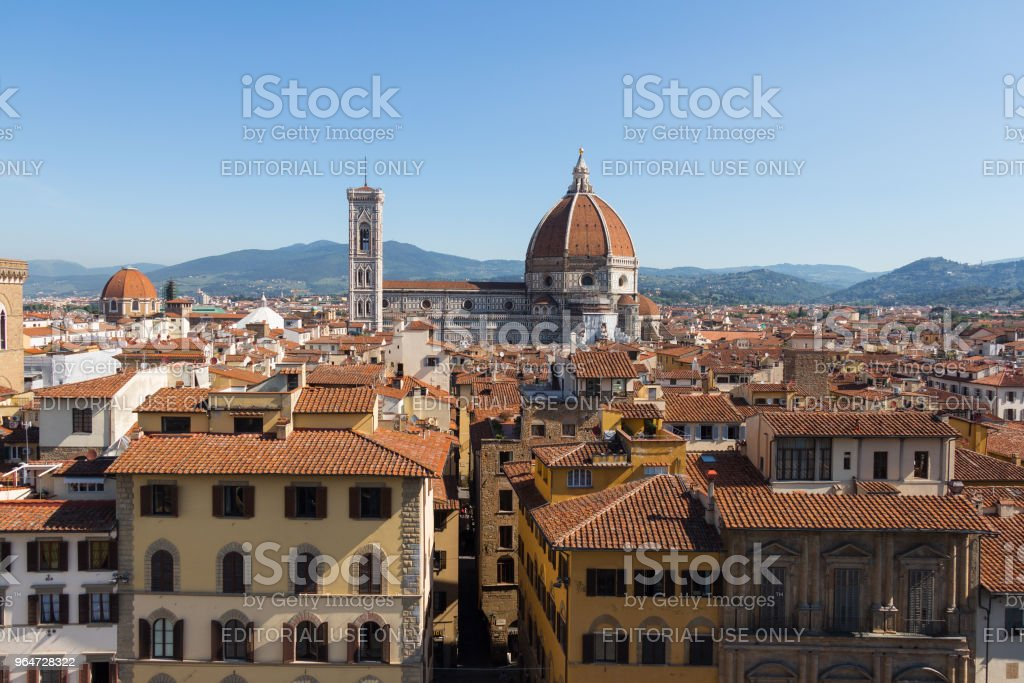 Cattedrale di Santa Maria del Fiore and red roofs of Florence in a sunny day, Tuscany, Italy. royalty-free stock photo