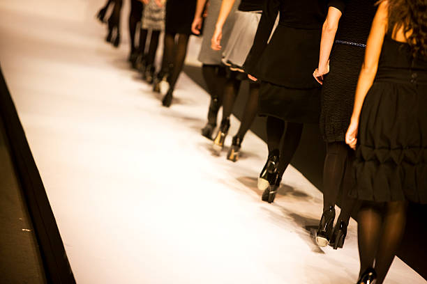 Catwalk Female models walking on catwalk,space for copy, canon 1Ds mark III ramp stock pictures, royalty-free photos & images