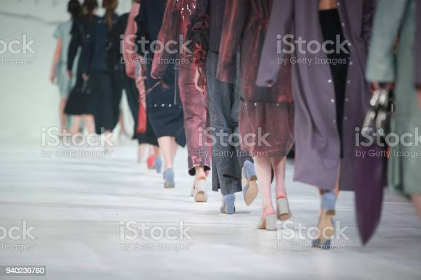 Fashion Show, Catwalk Runway Show Event. Detail of lined up rear view, fashion models.